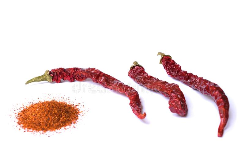 Dried red chili pepper on white background. Desiccated milled paprika. royalty free stock images