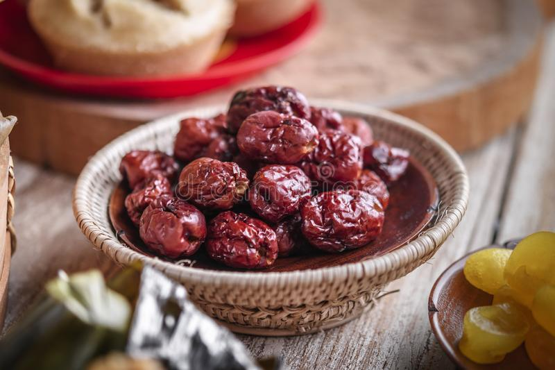 Dried red date or Chinese jujube. Traditional herbal medicine spill. On wooden agriculture asian autumn background basket big china crop dates delicious desert royalty free stock photos