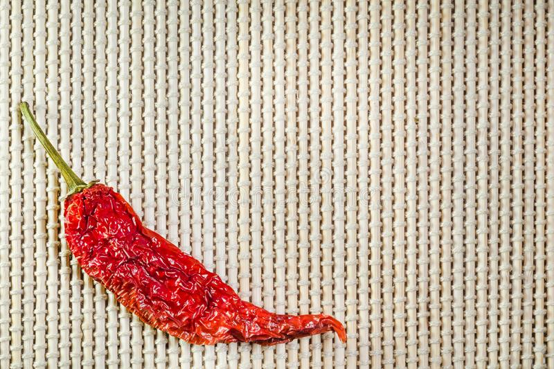 Dried red hot chili pepper on a bamboo serviette.  royalty free stock photo
