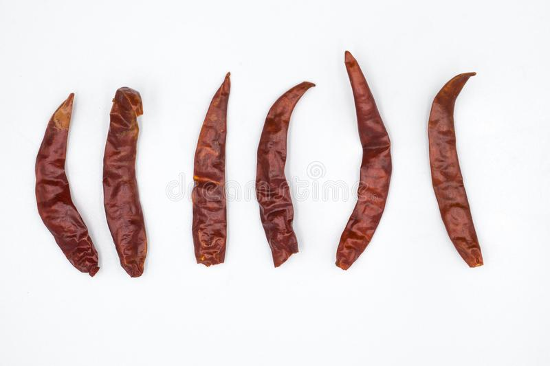 Dried red hot chili pepper isolated on white background. Top view royalty free stock photos