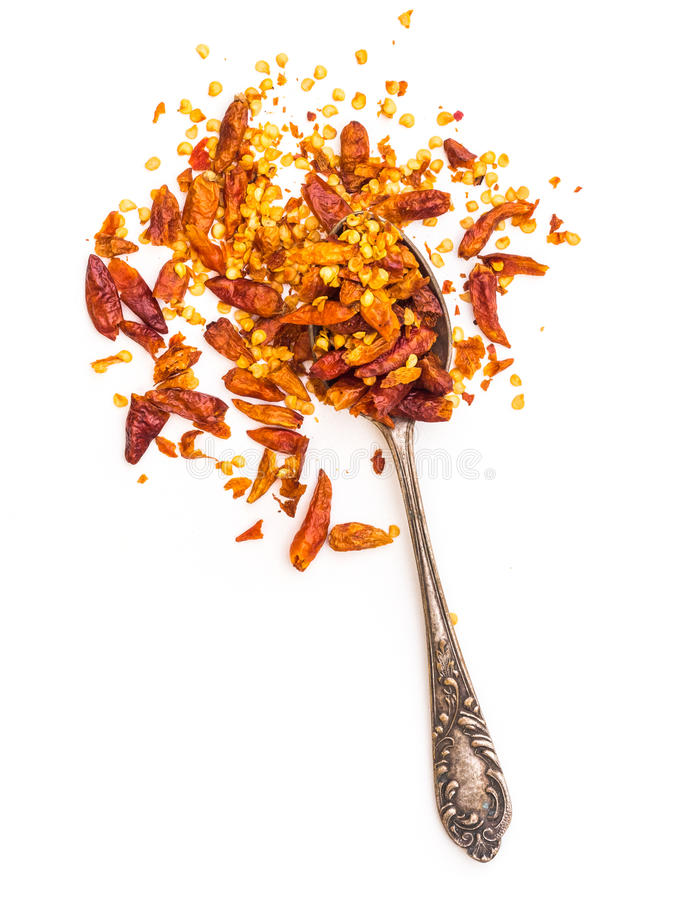 Dried red peppers in a spoon. Isolated on a white background royalty free stock image