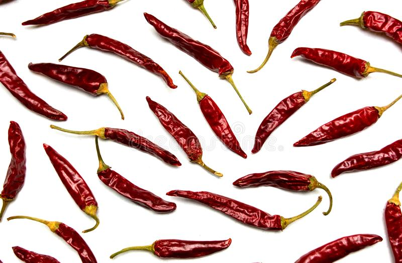 Dried red peppers on white background stock photos