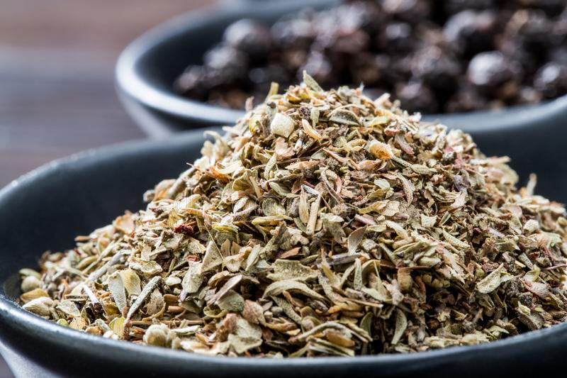 Dried Rosemary herb in black bowl close up macro. Dry, background, aroma, aromatic, closeup, condiment, cook, cooking, cuisine, culinary, flavor, food, fresh stock photos