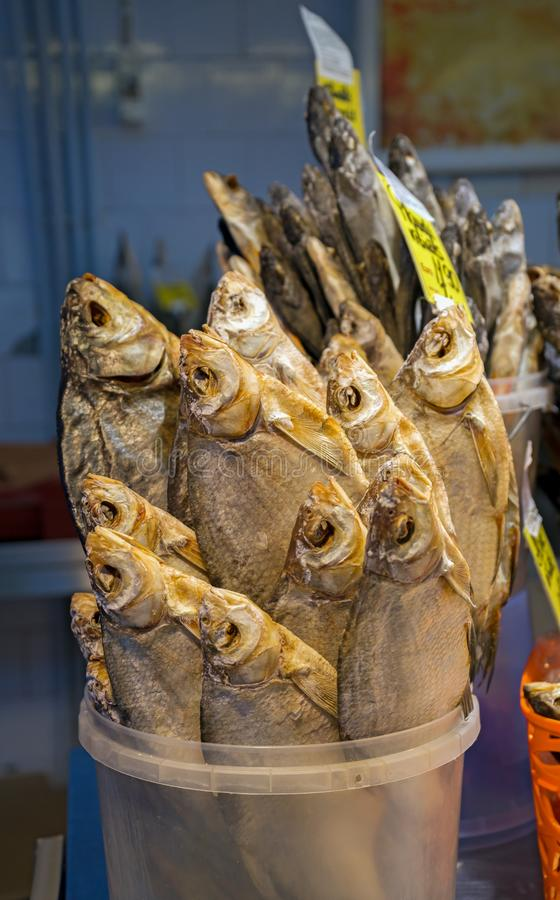 Dried salted fish vobla on the counter for sale, traditional beer snack stock photos