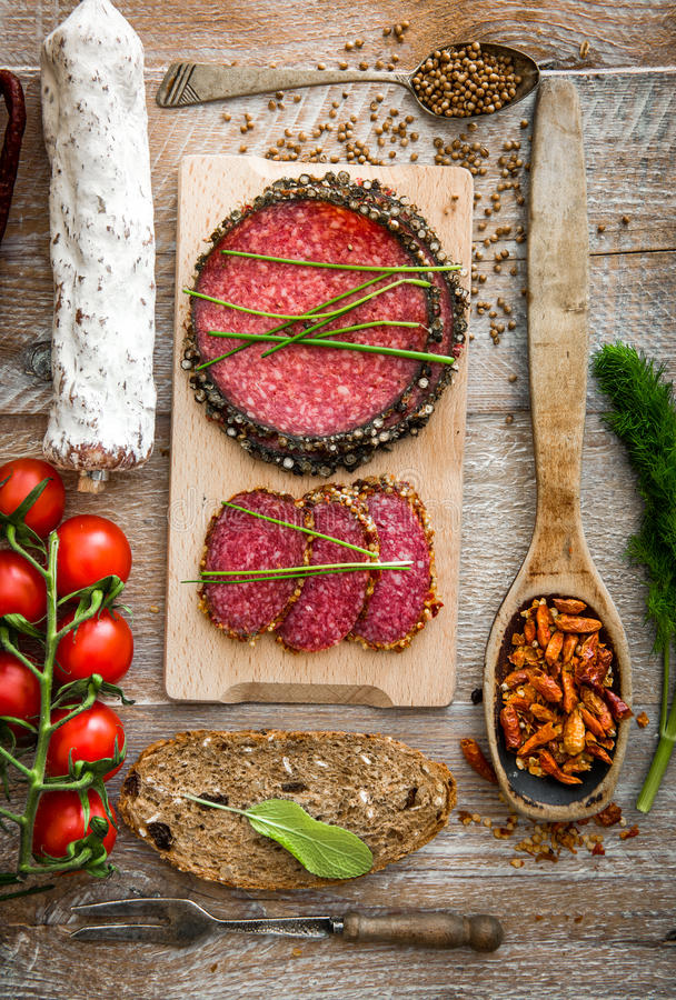 Dried sausage on a wooden table royalty free stock image