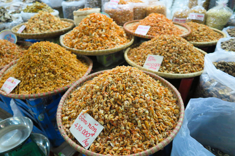 Dried shrimps sold in the vietnamese market. Dried shrimps and other seafood sold in the streetmarket, Vietnam stock photography