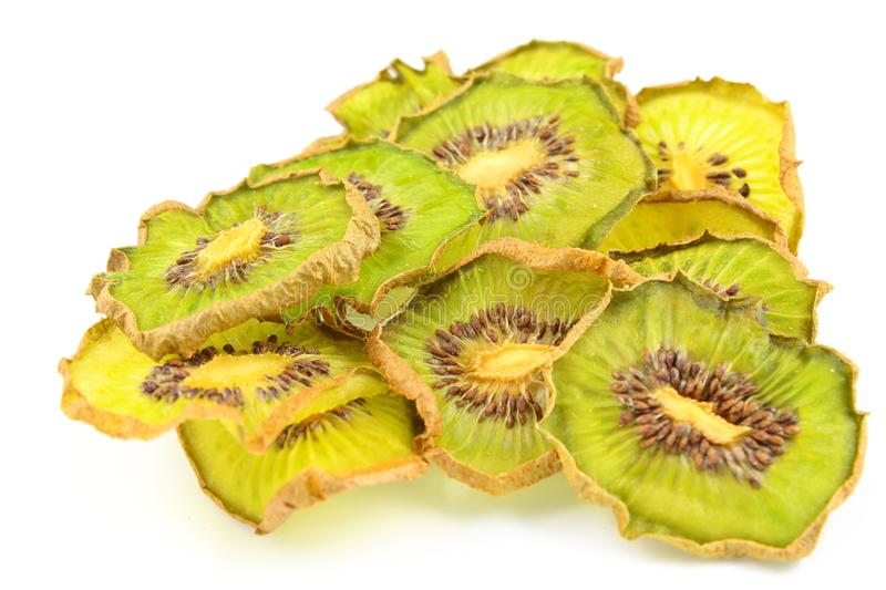 Dried slices of green kiwi fruits isolated on a white background. Composition of dried slices of green kiwi fruits isolated on a white background stock photos