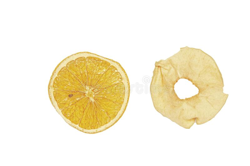 Dried slices of orange and apple for mulled wine on a white background. Isolate royalty free stock photography