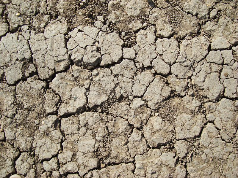 Dried soil in cracks royalty free stock photography