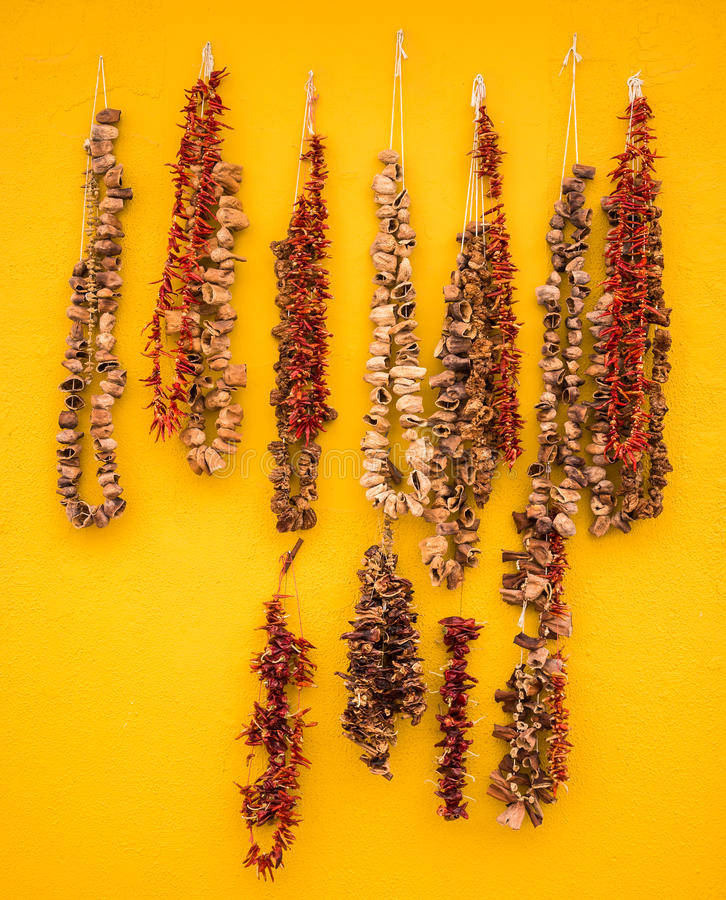 Dried Food Spices. Dried chillies and other food spices on display on a yellow wall. Crete, Greece stock photo