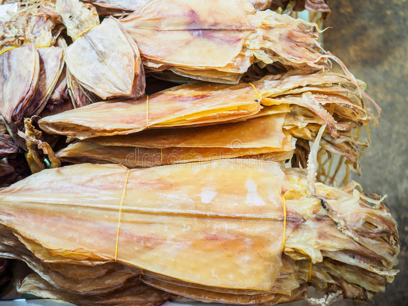 Dried squid, preserved food, at the seafood market. stock photos