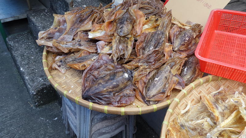 Dried squid for sale in market stock photo
