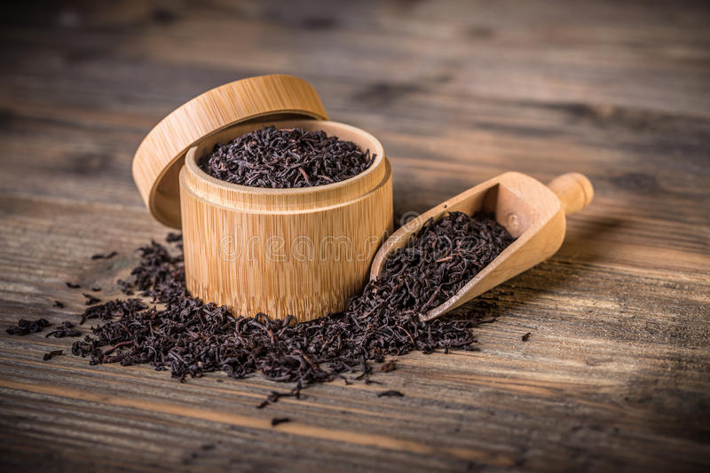 Dried tea leaves. In bamboo box stock photography