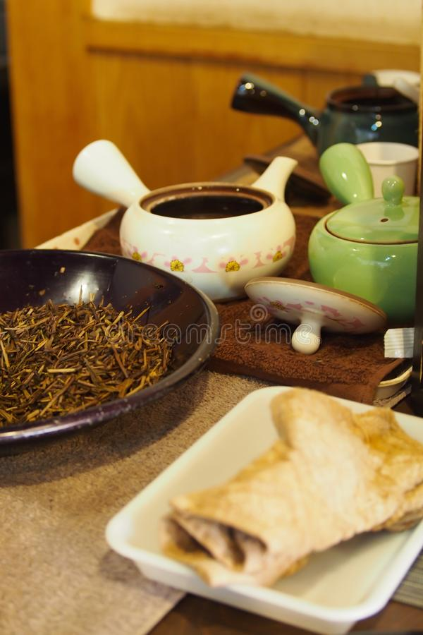 Dried tea leaves, packed in clay pots stock photo