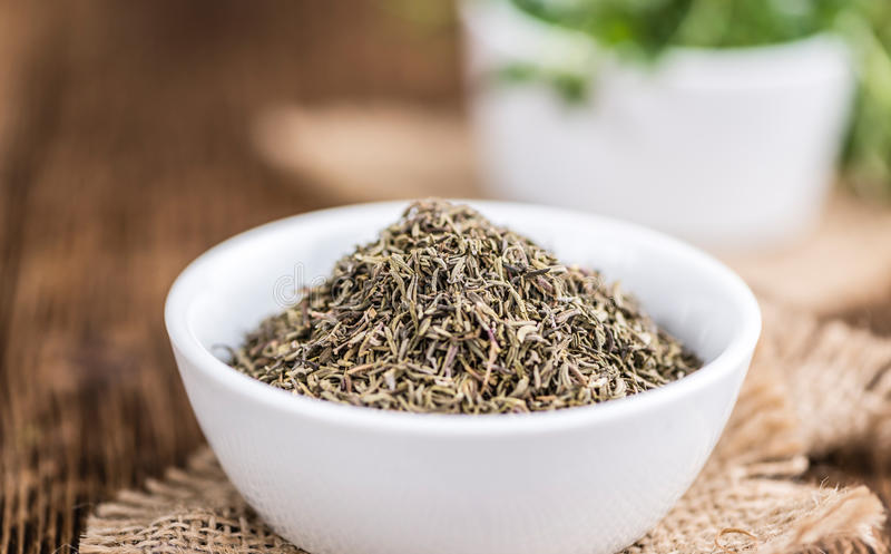 Dried Thyme on wooden background. (selective focus; close-up shot royalty free stock photography