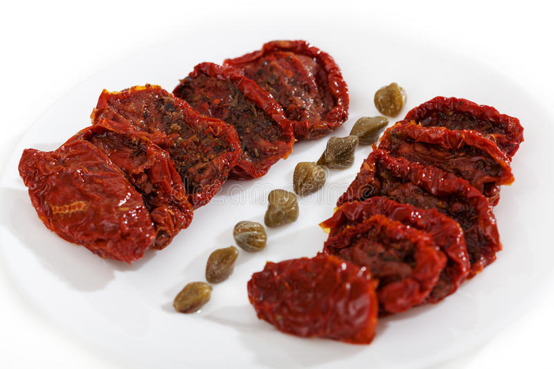 Dried tomatoes with capers stock photography