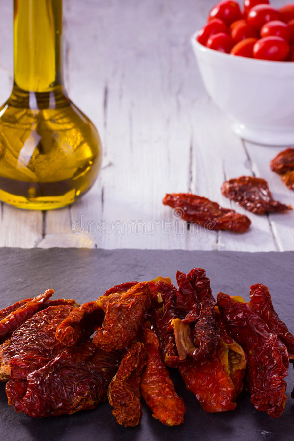 Dried tomatoes and cherry tomatoes with oil royalty free stock photos