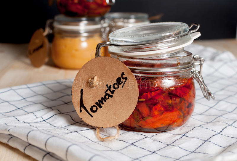 Dried tomatoes in a jar stock photo