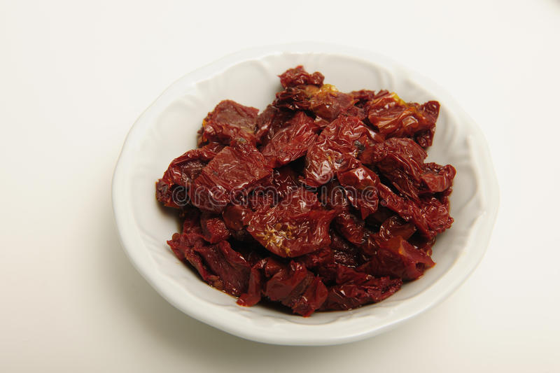 Download Dried Tomatoes In White Dish Stock Photo - Image: 12939196