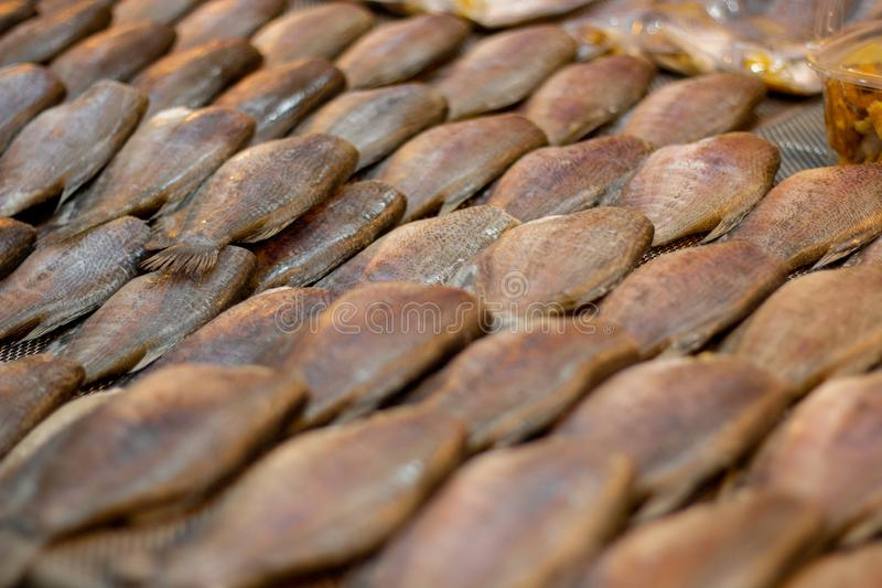Dried Trichogaster pectoralis fish , Sun dried fish. In the market stock photography
