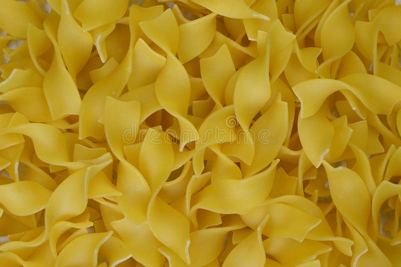 Dried uncooked fettuccine noodles royalty free stock image