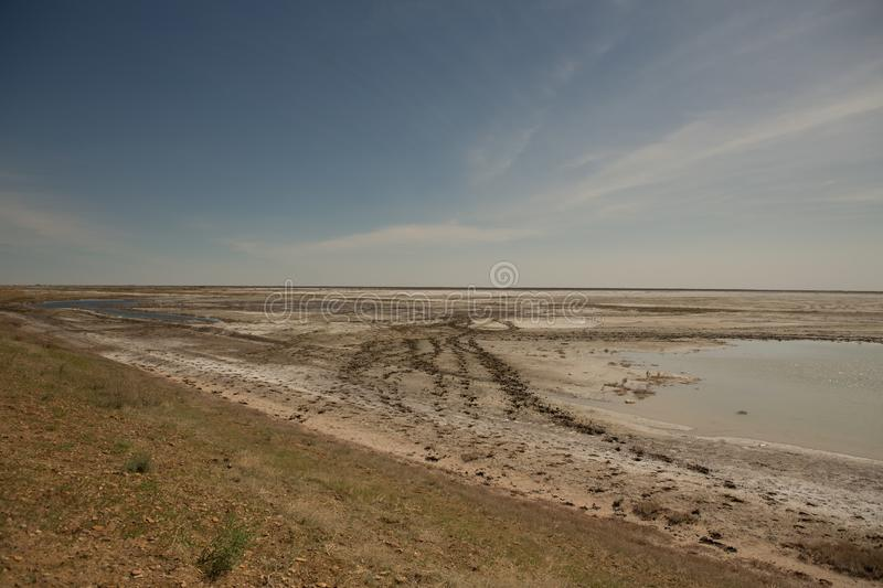 The dried-up Aral sea in summer, the water crisis on the planet and the concept of climate change. The dried-up Aral sea, the water crisis on the planet and the stock images