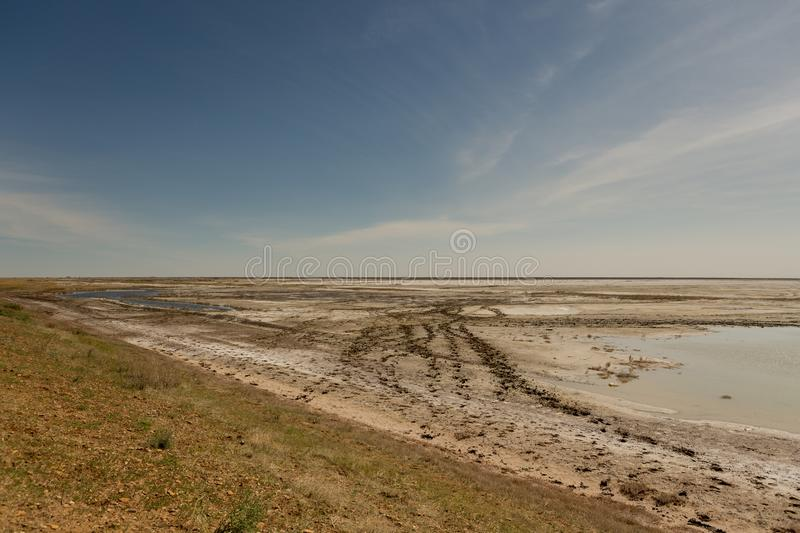 The dried-up Aral sea in summer, the water crisis on the planet and the concept of climate change. The dried-up Aral sea, the water crisis on the planet and the royalty free stock photo