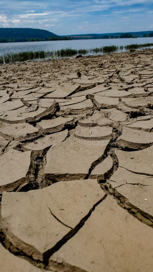 Dried up river bed with river in background stock photos
