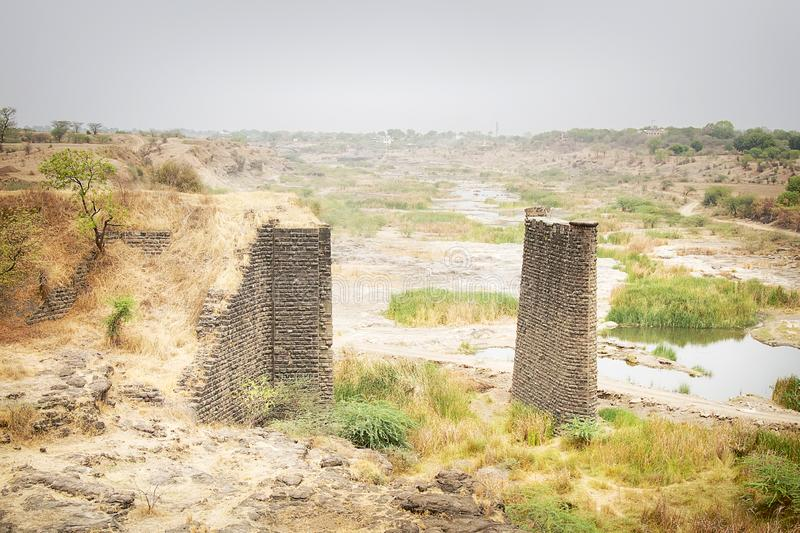 Dried up river and supports of the old bridge. Dried up river and brick supports of the old bridge in India, bridge substructure stock photo
