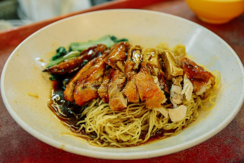 Dried Won Ton noodles with roasted BBQ chicken, Wan tan mee , Chinese cuisine stock photography