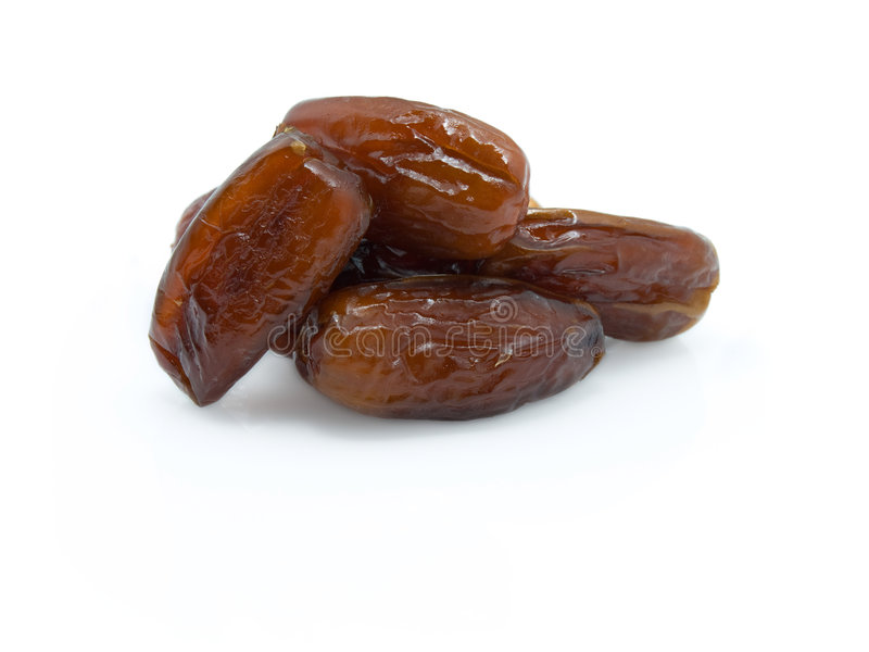 Dries dates on a white background royalty free stock image