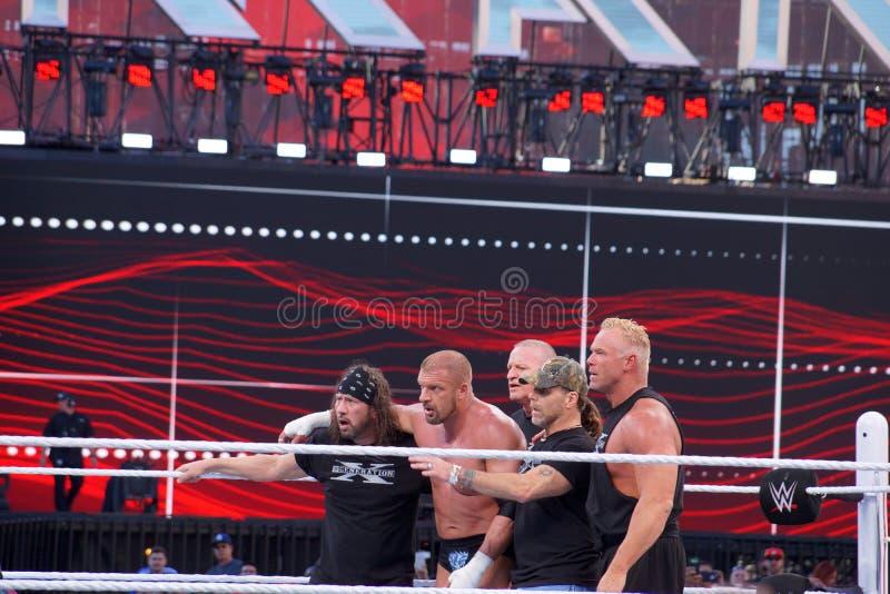 Drievoudig H houdt voorhamer en Sting houdt knuppel in ring tijdens m royalty-vrije stock afbeelding