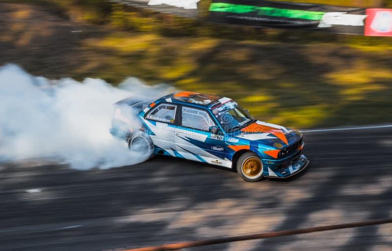 Drift Car on the Race Track. In Bikenieki are drifting stock photo
