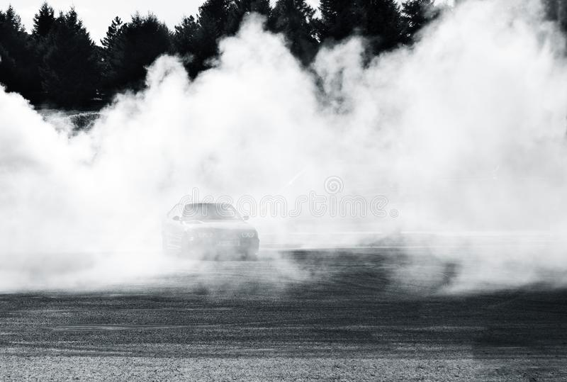 Drift car show at the Bucharest Auto Show. Sport car wheel drifting, surrounded by smoke royalty free stock photography