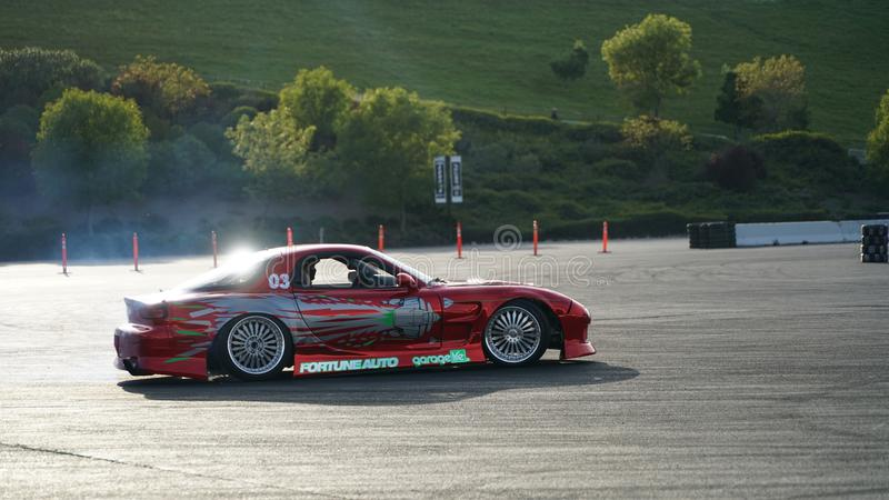 Racing car drift with smoking tyres. Drift racing, drifting car, street racing, smoking tyres and fast driving. Drift car in action stock photo