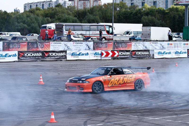 Drift show Orange team. MOSCOW - AUGUST 25: Drift show Orange team at the international exhibition of the auto and components industry, Interauto on August 25 royalty free stock photography