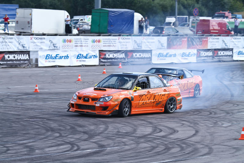 Drift show Orange team. MOSCOW - AUGUST 25: Drift show Orange team at the international exhibition of the auto and components industry, Interauto on August 25 royalty free stock image