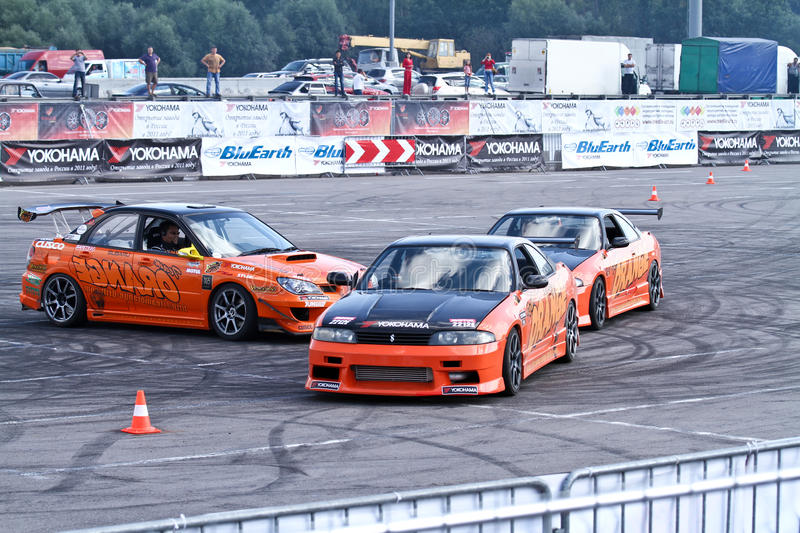Drift show Orange team. MOSCOW - AUGUST 25: Drift show Orange team at the international exhibition of the auto and components industry, Interauto on August 25 royalty free stock images