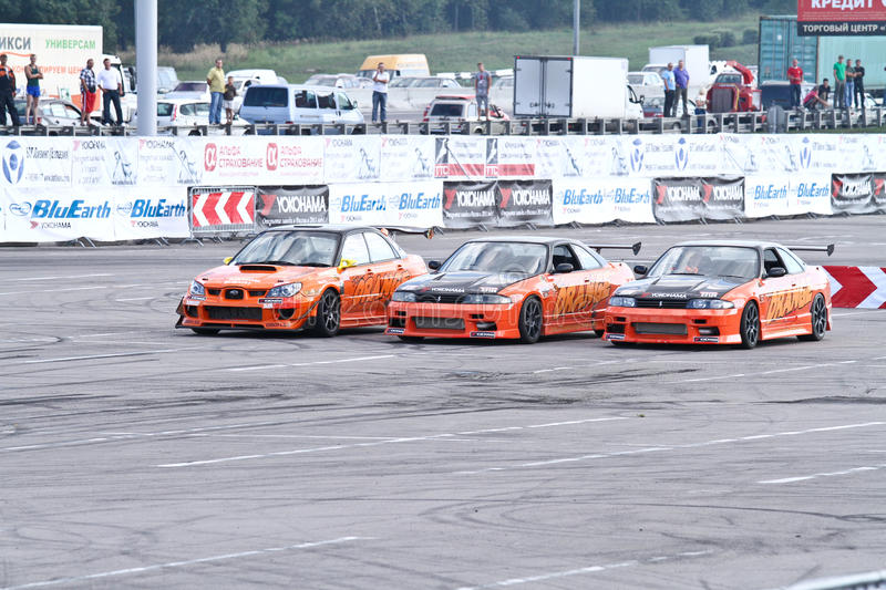 Drift show Orange team. MOSCOW - AUGUST 25: Drift show Orange team at the international exhibition of the auto and components industry, Interauto on August 25 stock photography