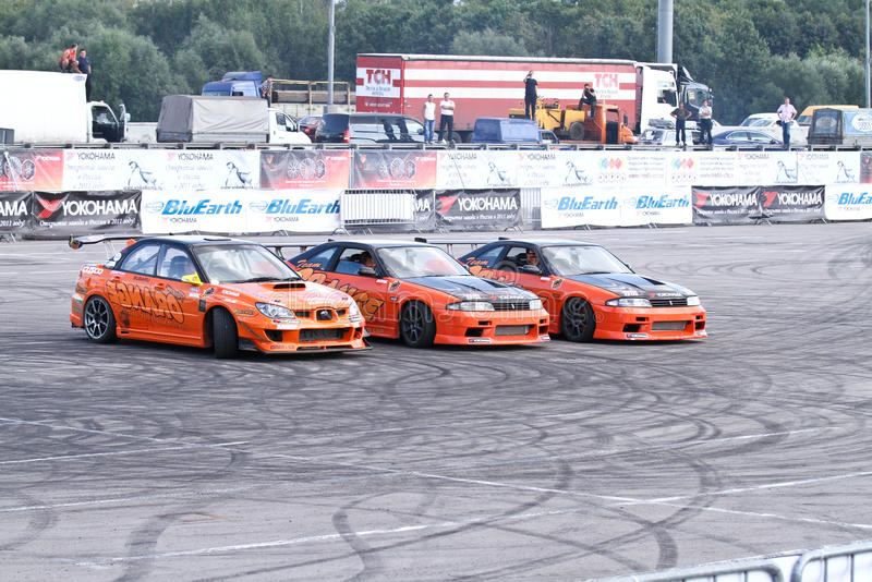 Drift show Orange team. MOSCOW - AUGUST 25: Drift show Orange team at the international exhibition of the auto and components industry, Interauto on August 25 royalty free stock photo