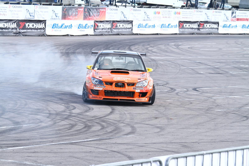 Drift show Orange team. MOSCOW - AUGUST 25: Drift show Orange team at the international exhibition of the auto and components industry, Interauto on August 25 royalty free stock photos