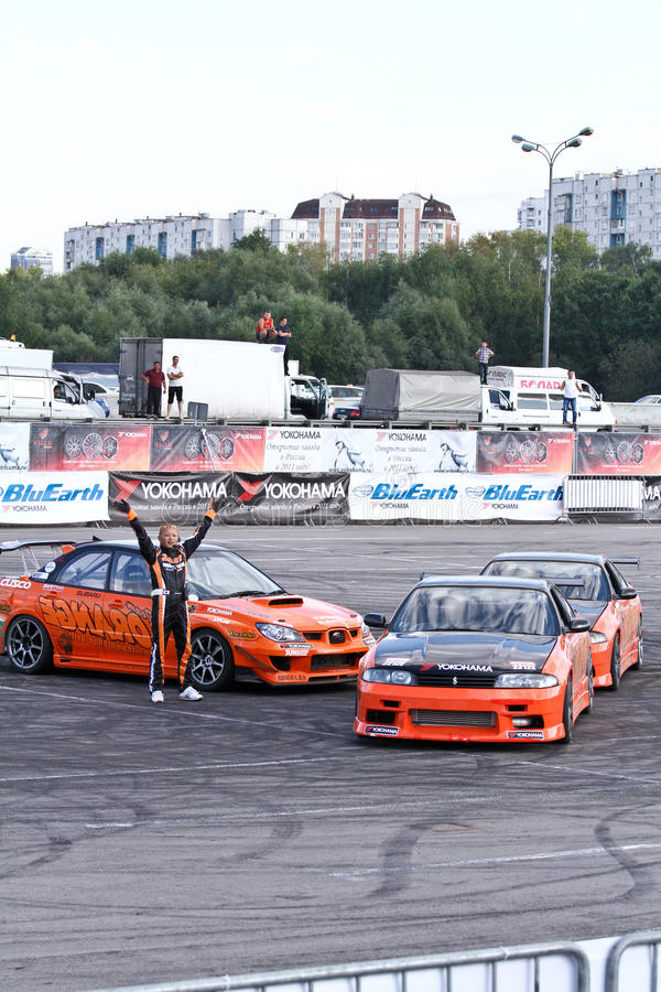 Drift show Orange team. MOSCOW - AUGUST 25: Drift show Orange team at the international exhibition of the auto and components industry, Interauto on August 25 stock photo