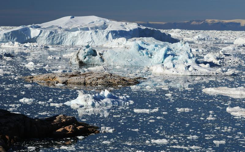 Icebergs in Greenland. Drifting icebergs in the bay of Ilulissat, Greenland royalty free stock photography