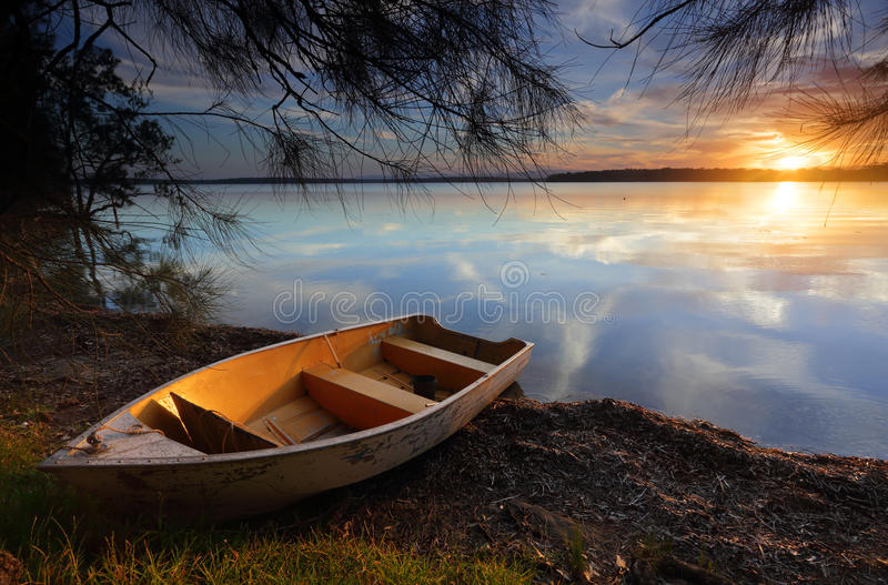 Drifting to new shores as the sun sets on another day stock image
