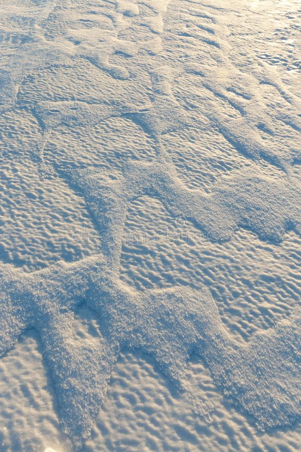 Drifts of white snow. Beautiful uneven drifts of white snow, winter on sunny days royalty free stock images