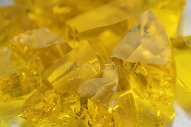 Driftstopp för matlagning för Collagen för mat för ny efterrätt för abstrakt begrepp för Jelly Sweet Marmalade Golden Pieces kubd royaltyfria foton