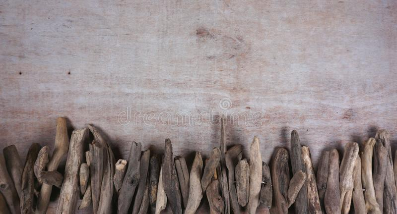 Driftwood at wooden background, decoration, maritime items, sea objects with copy space for your own text royalty free stock images