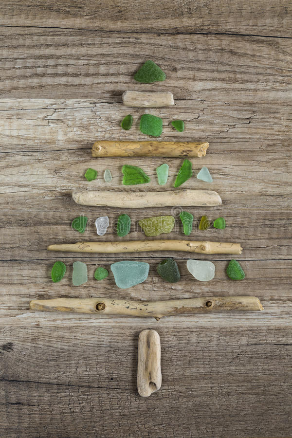 Driftwood christmas tree with polished green glass royalty free stock photos