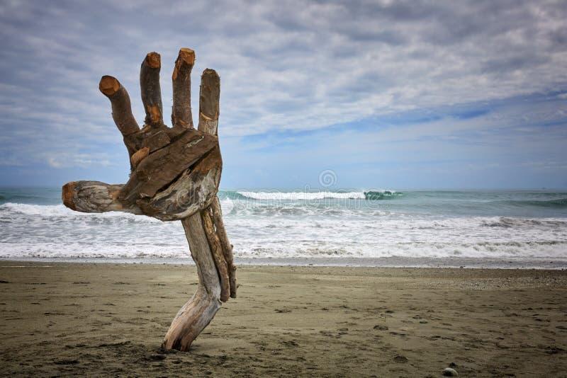 Driftwood Hand Sculpture Hokitika. Driftwood hand sculpture at Hokitika beach sculpture festival New Zealand royalty free stock photo