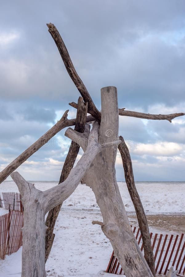 driftwood teepee along frozen beach of Lake Michigan in Chicago royalty free stock photography